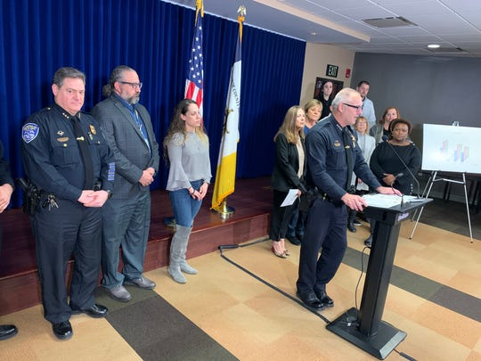 Sheriff Todd Baxter, in the foreground, presents the findings of the Monroe County Heroin Task Force Thursday at the Monroe Sheriff's Office headquarters in downtown Rochester.