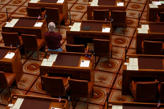 Sen. Chuck Riley, D-Hillsboro, stands among empty Republican desks during a Senate floor session in the Oregon State Capitol Building in Salem, Oregon, on March 5, 2020.