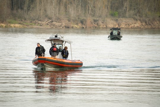 Law enforcement officials patrol in a Marion County Sheriff's Office marine patrol boat as divers from the Clackamas County Sheriff's Office search the water near the Wheatland Ferry March 5, 2020. They resumed their search for an SUV that drove off the ferry ramp and into the Willamette River on the Marion County side, just north of Keizer the night before.