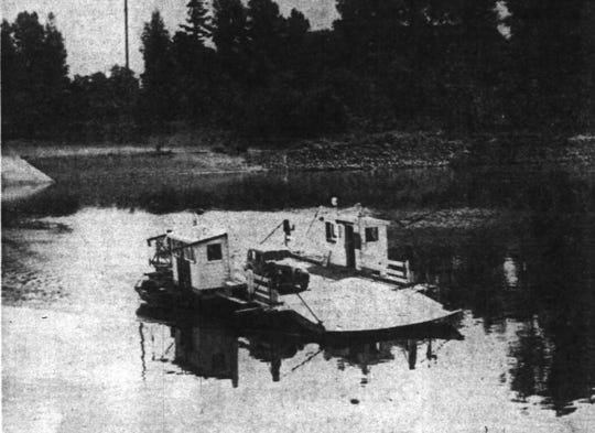 A vehicle on the Wheatland Ferry crosses the Willamette River. Photo appeared in the January 30, 1950 edition of The Oregon Statesman.