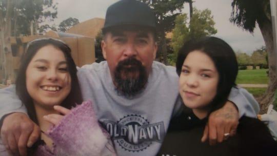 Arturo Ramirez, 54, appears with his grandchildren in this undated photo.