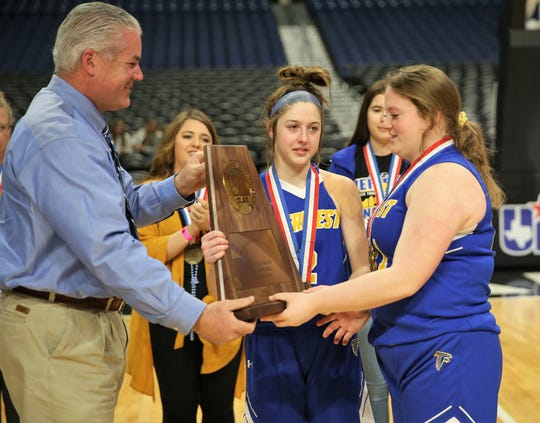 Veribest High School's Zoe Bratcher holds the third-place trophy after the Lady Falcons lost 43-23 against Nazareth in the UIL Class 1A state basketball semifinals at the Alamodome in San Antonio on Thursday, March 5, 2020.