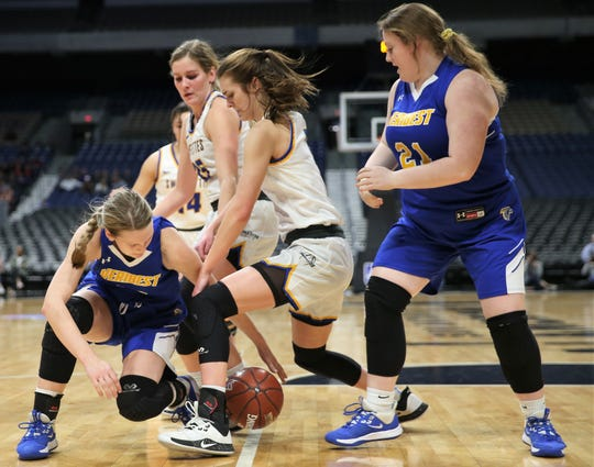 Veribest High School's Bella Halfmann tries to maintain possession of the ball as teammate Piper Compton looks on during a Class 1A girls basketball state semifinal game against Nazareth at the Alamodome in San Antonio on Thursday, March 5, 2020.