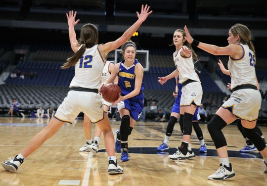 Veribest High School's Zoe Bratcher tries to get through Nazareth players during a Class 1A girls basketball state semifinal game at the Alamodome in San Antonio on Thursday, March 5, 2020.