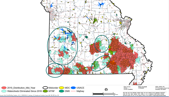 This is a part of a map provided by the Missouri Department of Conservation. The circles indicate watersheds where feral hogs had been eradicated as of mid-2019.