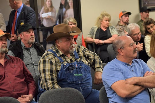 Mike Bell, a farmer in Shannon County, listens to testimony on a bill that would reopen public lands to feral hog hunting on Monday, March 2, 2020.