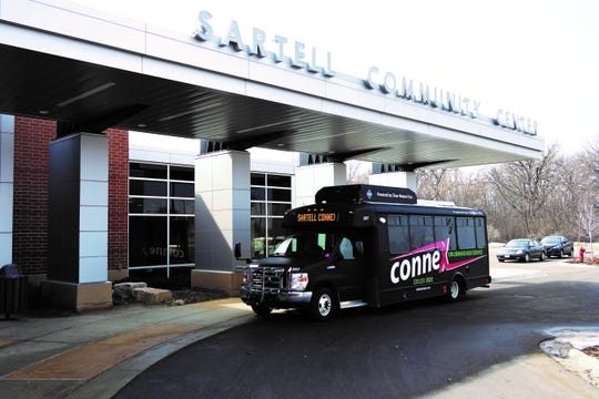 A ConneX bus sits outside the Sartell Community Center in Sartell.