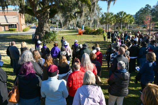 On Saturday, Feb. 29, more than 100 people gathered in Cascades Park to honor the lives of the four documented victims of lynching in Leon County: Pierce Taylor, Mick Morris, Ernest Ponder, and Richard Hawkins.