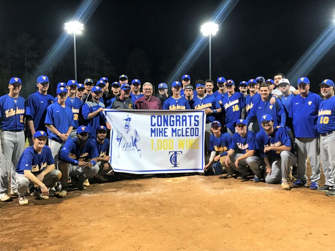 TCC players gather a home plate for the postgame celebration of head coach Mike McLeod after his 1,000th victory on Wednesday, March 4, 2020.