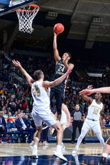 Mar 4, 2020; South Bend, Indiana, USA; Florida State Seminoles guard Devin Vassell (24) goes up for a shot as Notre Dame Fighting Irish forward John Mooney (33) defends in the first half at the Purcell Pavilion. Mandatory Credit: Matt Cashore-USA TODAY Sports