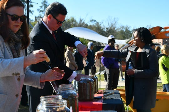 The Soil Collection Ceremony, hosted by the Tallahassee Community Remembrance Project, encouraged participants to shovel soil collected from the site of two former Leon County jails and fill eight jars—two for each of the four men.