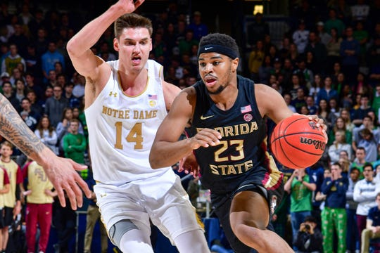 Mar 4, 2020; South Bend, Indiana, USA; Florida State Seminoles guard M.J. Walker (23) drives to the basket as Notre Dame Fighting Irish forward Nate Laszewski (14) defends in the first half at the Purcell Pavilion. Mandatory Credit: Matt Cashore-USA TODAY Sports