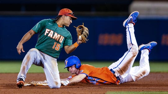 Florida's Brock Edge (18) steals second, beating the tag by Florida A&M infielder Octavien Moyer (15) during the eighth inning of an NCAA college baseball game Wednesday, March 4, 2020, in Gainesville, Fla. (AP Photo/Gary McCullough)
