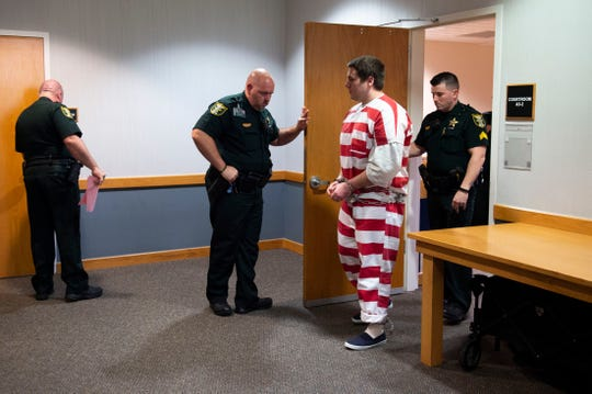 Austin Harrouff, accused of murdering a Tequesta couple in 2016, is escorted out of a status hearing by Martin County Sheriff's deputies on Thursday, March 5, 2020, at the Martin County Courthouse in Stuart. A state-hired psychologist recently concluded Harrouff was legally insane at the time of the crime and the judge agreed to cancel the May 18 trial after state prosecutors requested to hire a second mental health expert to evaluate Harrouff.