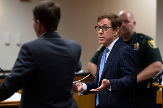 Attorney Bob Watson, representing accused murderer Austin Harrouff, argues with Assistant State Attorney Brandon White (left) during a status hearing in front of Martin County Circuit Judge Sherwood Bauer on Thursday, March 5, 2020, at the Martin County Courthouse in Stuart.