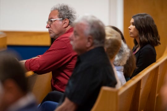Wade Harrouff, father of Austin Harrouff, accused of murdering a Tequesta couple in 2016, and other family members, attend a status hearing Thursday, March 5, 2020, at the Martin County Courthouse in Stuart.