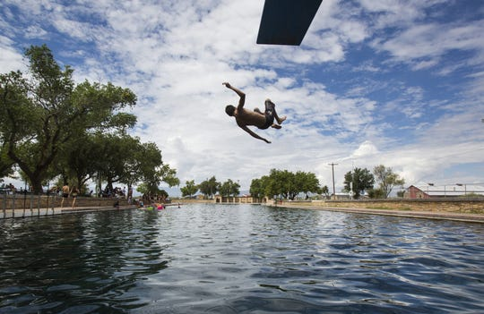 In this 2016 photo, a boy jumps off the diving board into 30 feet of water at the natural spring pool at the Balmoreah State Park in Balmoreah, Texas. The park is closed through the summer due to ongoing renovations.