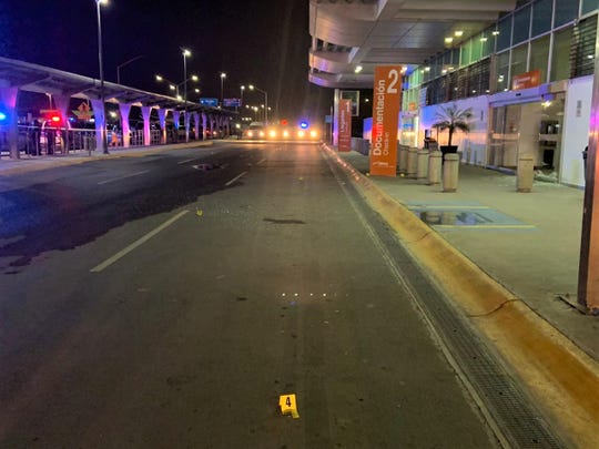Yellow evidence markers sit at the entrance of the Juárez airport terminal after a shootout on Wednesday night, March 4, 2020.