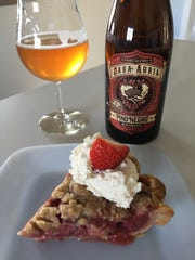 A slice of Oxnard-grown strawberry pie is seen with a glass of Casa Agria Pino Negro saison from Casa Agria Specialty Ales in Oxnard. The pie-and-beer pairing was served during a private brunch at the Santa Paula home of 805 Pies founder Jessica Zavala and husband Augustine Zavala.