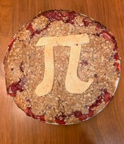 Jessica Zavala's Pi Day pie last year was cherry with an oatmeal-crumble topping and a pie-crust pi symbol drawn by husband Augustine Zavala.