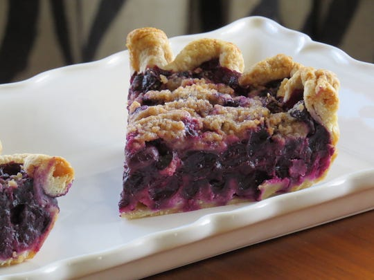 """""""A good filling to me is one where, when you cut it, it all comes out together,"""" says Jessica Zavala, owner of 805 Pies. Slices of her blueberry pie are seen here."""