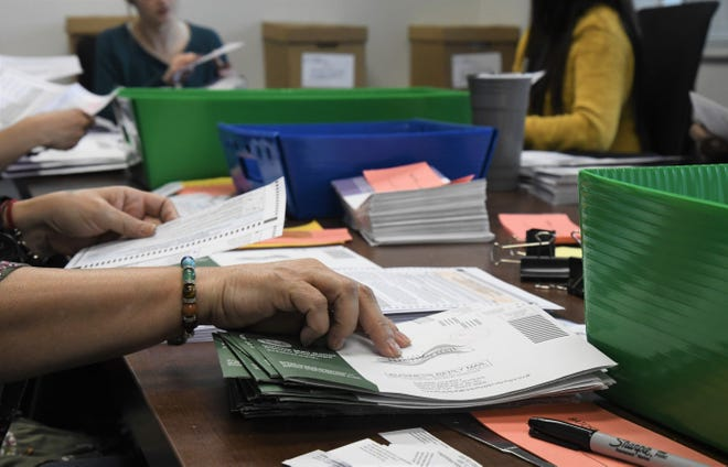 Eight extra-help workers are assisting the Tulare County Registrar of Voters as it continues to count vote-by-mail and provisional ballots on Thursday, March 5, 2020.