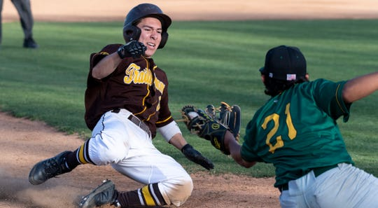 Golden West's Nick Lopez slides into a tag at third from Kingsburg's Michael Delgado in a non-league high school baseball game on Wednesday, March 4, 2020.
