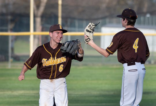 Golden West's Nick Lopez, left, and Brian Gilbert celebrate a win over Kingsburg in non-league high school baseball game on Wednesday, March 4, 2020.