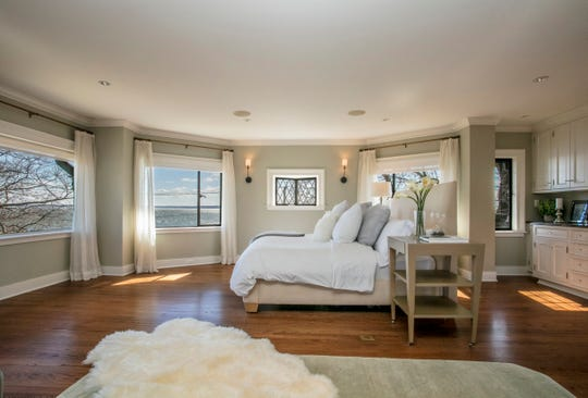 The master suite spreads over two floors and includes a wood burning fireplace, wine fridge as well as a lounge and office.