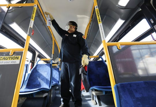 Senior utility worker Cesar Velez disinfects a bus at the  Liberty Lines Bus Depot in Yonkers on Thursday, March 5, 2020.