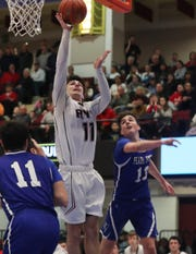 Rye's Quinn Kelly (11) goes up for a shot in front of Pearl River's John Hayes (13) during the boys Class A semifinal at the Westchester County Center in White Plains March 4, 2020. Rye won the game 53-46.