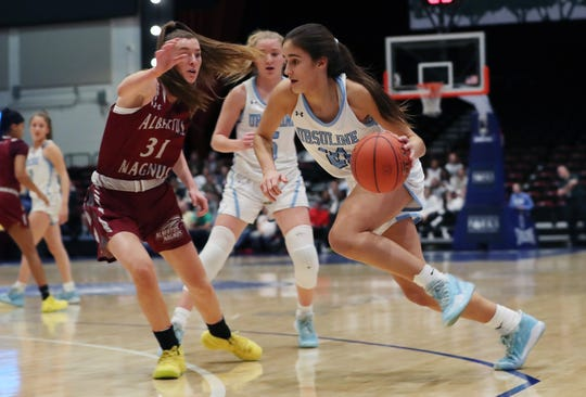 Ursuline's Sonia Citron (21) drives to the basket against Magnus during the girls  Class AA semifinal at the Westchester County Center in White Plains March 5, 2020.