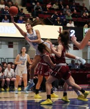 Ursuline's Sonia Citron (21) goes over Magnus defenders on the way to a basket during the girls  Class AA semifinal at the Westchester County Center in White Plains March 5, 2020.