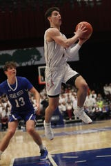 Rye's Matthew Tepedino (1) drives to the basket in front of Pearl River's John Hayes (13) during the boys Class A semifinal at the Westchester County Center in White Plains March 4, 2020. Rye won the game 53-46.