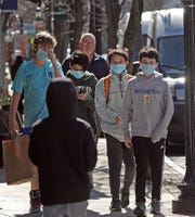 A group of kids wear face mask as they walk downtown Hastings as schools are closed in Hastings in concerns of coronavirus on March 5, 2020.