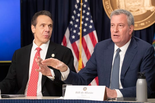 New York Gov. Andrew Cuomo, left, and Mayor Bill de Blasio discuss the state and city's preparedness for the spread of coronavirus at a news conference, Monday, March 2, 2020 in New York.