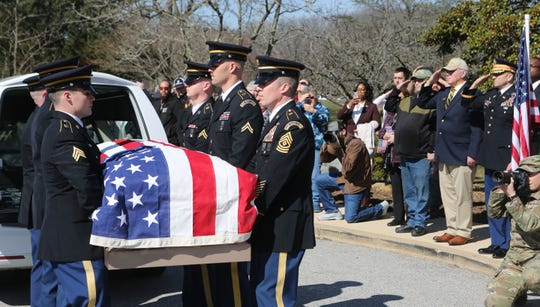 The body of Allister Barker is carried out of a vehicle Thursday morning at the Delaware Veterans Memorial Cemetery.