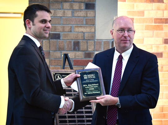 James Rowland, left, receives the Dillard Young Alumni of the Year award from Dr. Jeff Stambaugh, dean of the Dillard College of Business Administration at Midwestern State University, named in honor of the late Kay Dillard. Rowland graduated from MSU Texas in 2009.