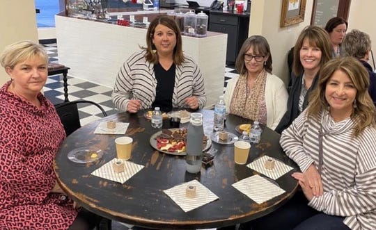 Senior Junior Forum members recently enjoyed an evening at B Cocoa Artisan Chocolate for their February social. Pictured, left to right: Delores Cully, Susan Phillips, Lori Wood, Vicki McCarty and Karol Gilbert.