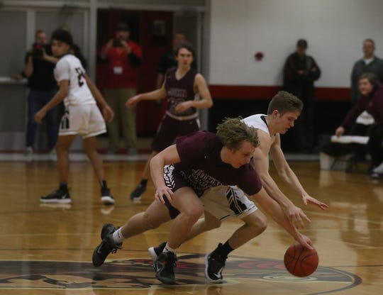 John Glenn's Reece Perkins and New Philadelphia's Ian Harr battle for the ball in the Division II district semifinal Wednesday at Coshocton.