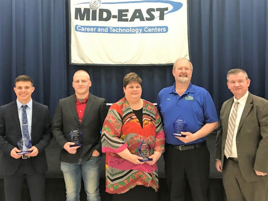 Jeremy Border, Ted Davis, Krystal McFarland and Gary Daymut are inducted into the Mid-East Career and Technology Centers Distinguished Alumni Hall of Fame by Superintendent Richard Hall.