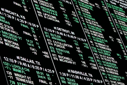 A board displays odds for different bets.