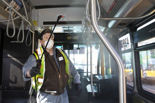 Larry Bowles, an equipment service worker for King County Metro, sprays Virex II 256, a disinfectant, throughout a metro bus at the King County Metro Atlantic/Central operating base on March 4, 2020 in Seattle, Wash. Metro's fleet of 1600 buses will get sprayed once a day to prevent the spread of the novel coronavirus, COVID-19.