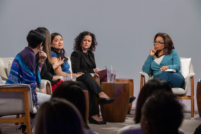 """Oprah Winfrey (right) hosts a taping of """"Oprah's Book Club"""" with Jeanine Cummins, author of """"American Dirt"""" (second right), and panelists (from left) Esther J. Cepeda, Julissa Arce and Reyna Grande in Tuscon, Ariz, on Feb. 13."""