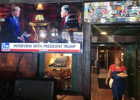 President Donald Trumps pre-game Super Bowl interview with Fox News host Sean Hannity is broadcast in a bar on February 2, 2020 in Washington, D.C.