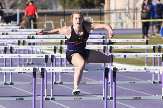 Wylie's Ambria Brekke clears a hurdle during the girls 100-meter hurdle run at the ACU Wildcat Relays at Elmer Gray Stadium on Thursday. Brekke won the 100 hurdles (15.79) and took seventh in the 300 hurdles (53.56).