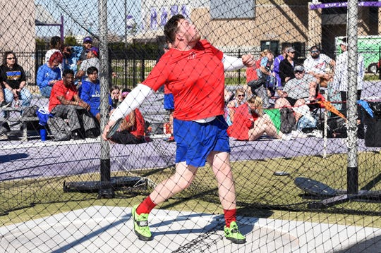 Cooper's McCord Whitaker competes during the boys discus at the ACU Wildcat Relays at Elmer Gray Stadium on Thursday. Whitaker won the discus with a throw of 161 feet, 10 inches and won the shot put at 46-8 to help lead the Cougars to a third-place team finish.