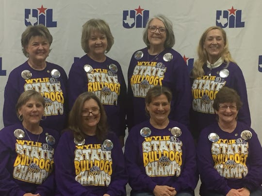 Eight members of the 1970 Class 1A state champion Wylie High School girls basketball team were honored Friday at this year's state tournament on the 50th anniversary of their accomplishment in Austin. The women are, bottom row from left, Sandy McKee Clay, Brenda Brzozowski Cannon, Pam Raughton  and Shirley McKee Gossard. Top row, from left, are Sandra Jackson Harris, Sharon Martin Foster, Nita Cowan Lawson and Marsha Doby Fowler. Other team members were Sharon Brzozowski, Judy Holloway, Susan Lucas and Carolyn Parris. Wylie went 31-2 that year, defeating Grandview in the final.