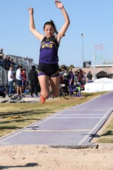 Wylie's Dusti Grant goes into the air during the girls triple jump at the ACU Wildcat Relays at Elmer Gray Stadium on Thursday. Grant won the triple jump (35-0), placed third in the 400 (1:03.26) and fifth in the long jump (16-4½) as the Lady Bulldogs finished fourth in the team standings.