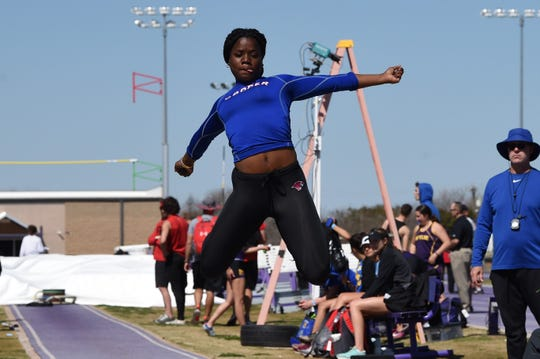 Cooper's Dazz Larkins goes into the air during the girls long jump at the ACU Wildcat Relays at Elmer Gray Stadium on Thursday. Larkins won the long jump (17-4¼) and was the 100 hurdles (16.49) runner-up.